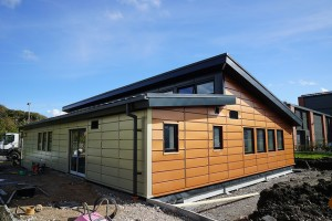 The completed classroom, clad in Tata Steel's perforated steel for generation of solar heat energy