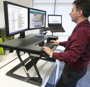Converting a fixed desk to sit-stand is one way to keep active