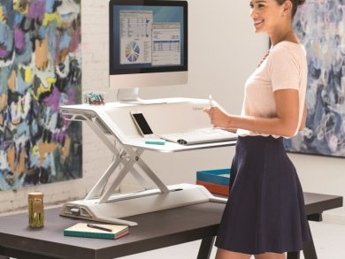 Sit-stand desks or platforms, like this one from Fellowes, can help employees reduce the amount of time they spend sitting down