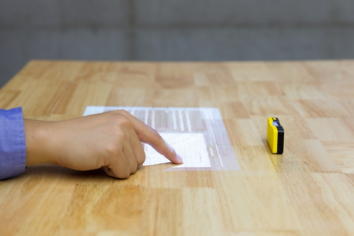 Turning any surface into a smart interface